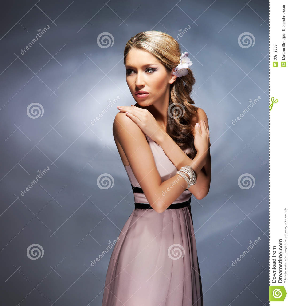 A Young Blond Woman Posing In A Pink Dress Stock Image