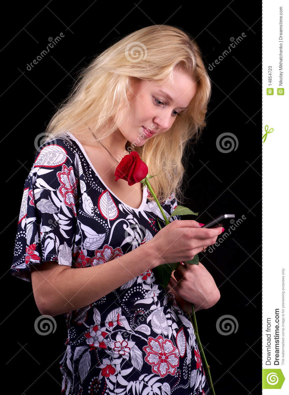 Young blond woman texting