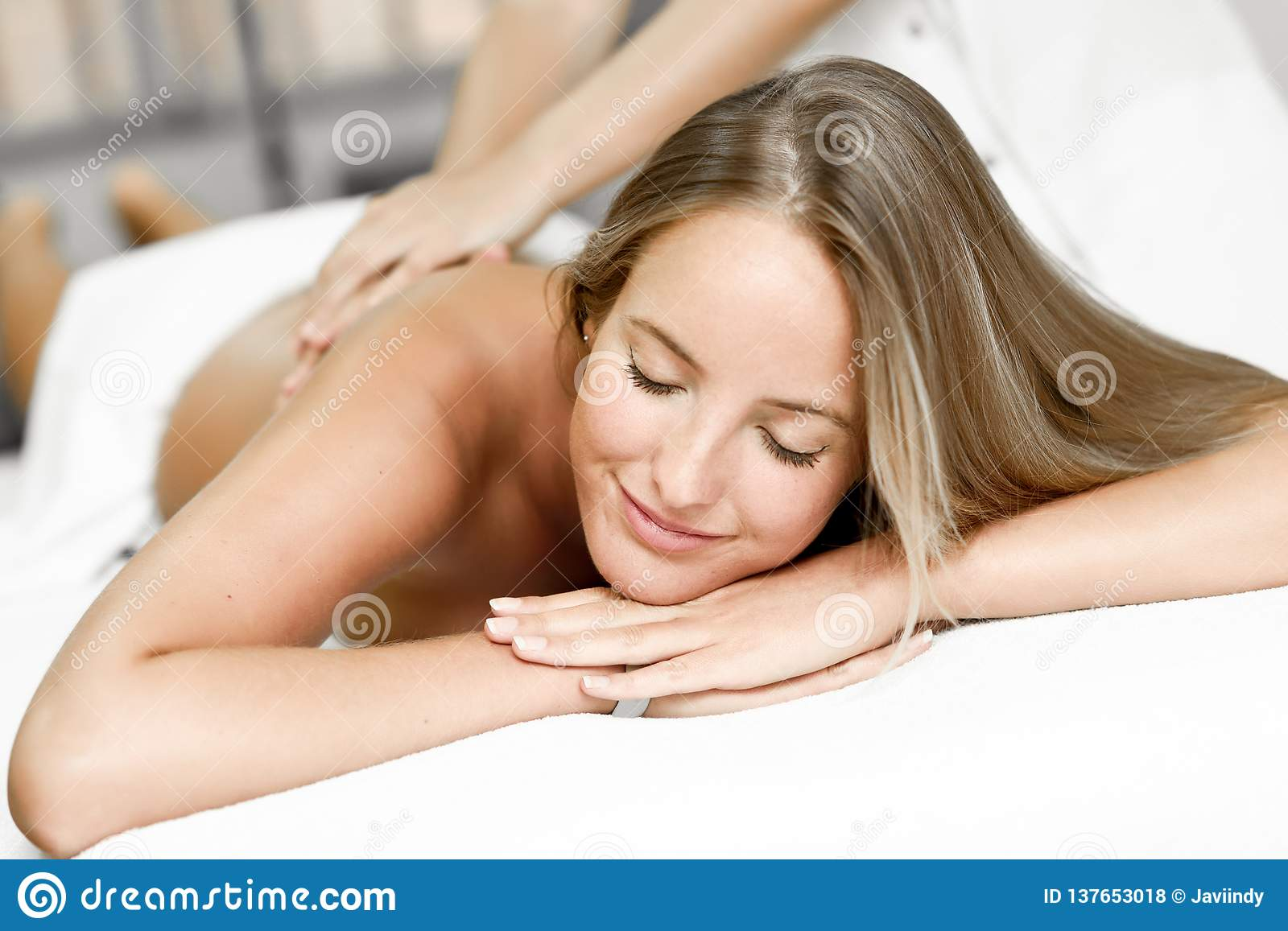Young Blond Women Having Massage In The Spa Salon Massage And Body Care Body Massage Treatment Smiling Female