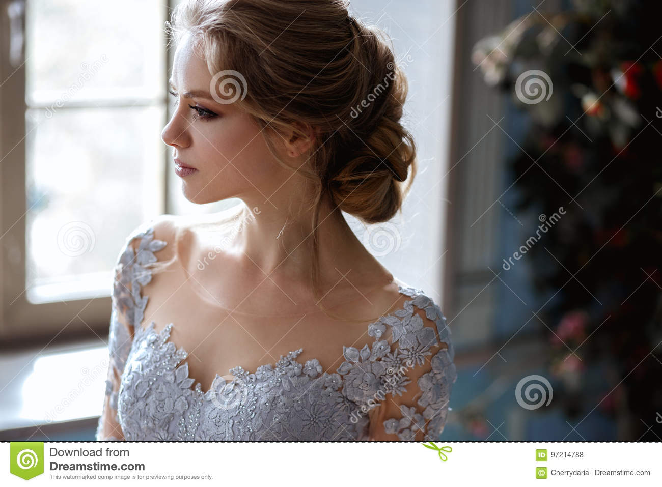 0db40a6af0e Young Blonde Bride Woman In A Light Blue Wedding Dress Stock Photo ...