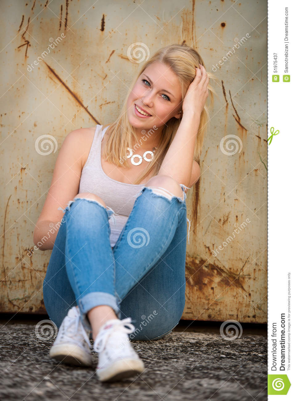 Young blonde caucasian girl alone on a street