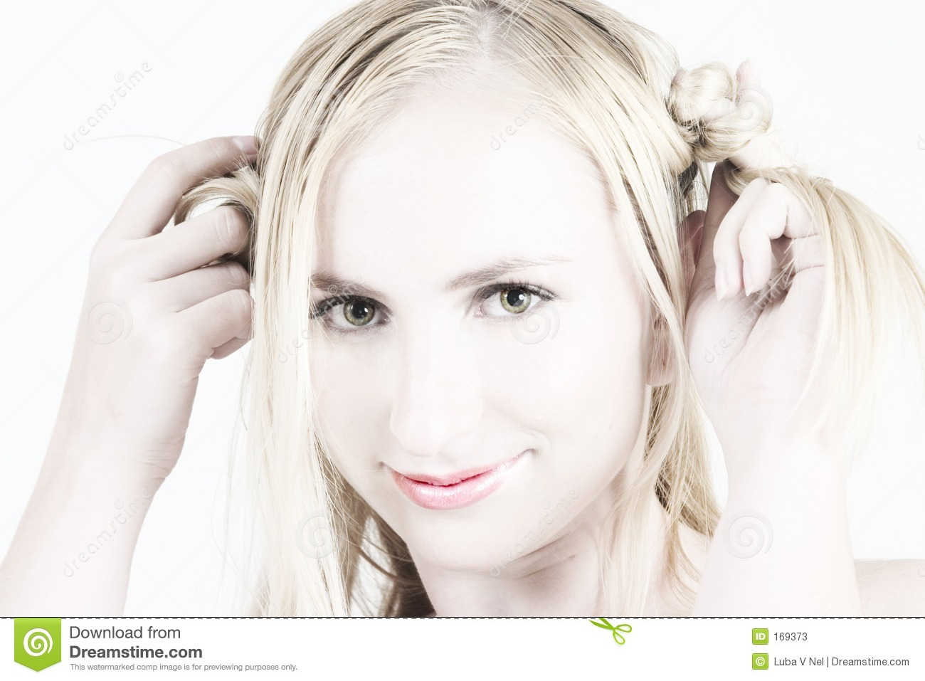 Young blonde girl playing with her hair