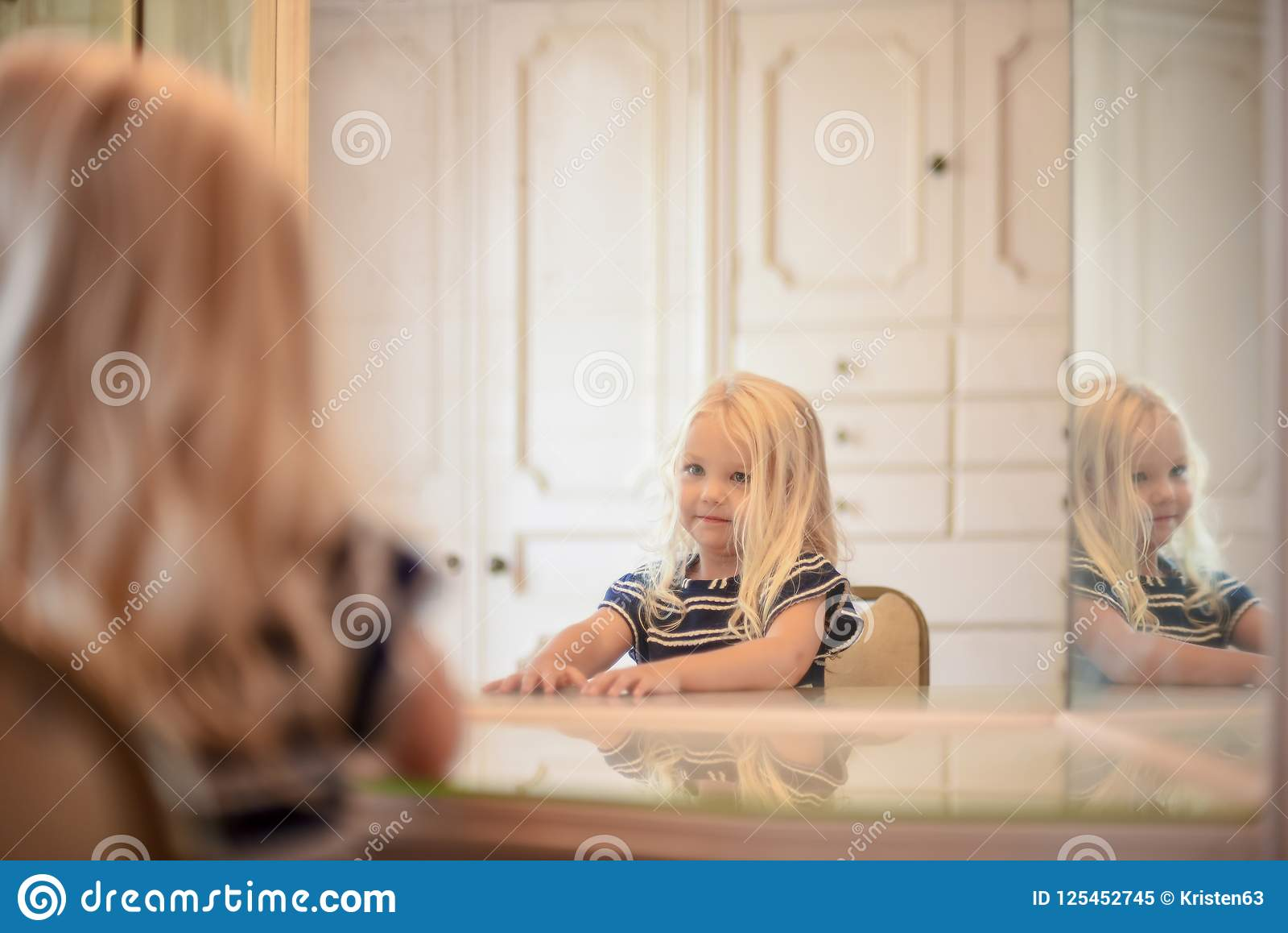 Young Blonde Girl Sitting At Vanity Mirror In Dressing Room Look
