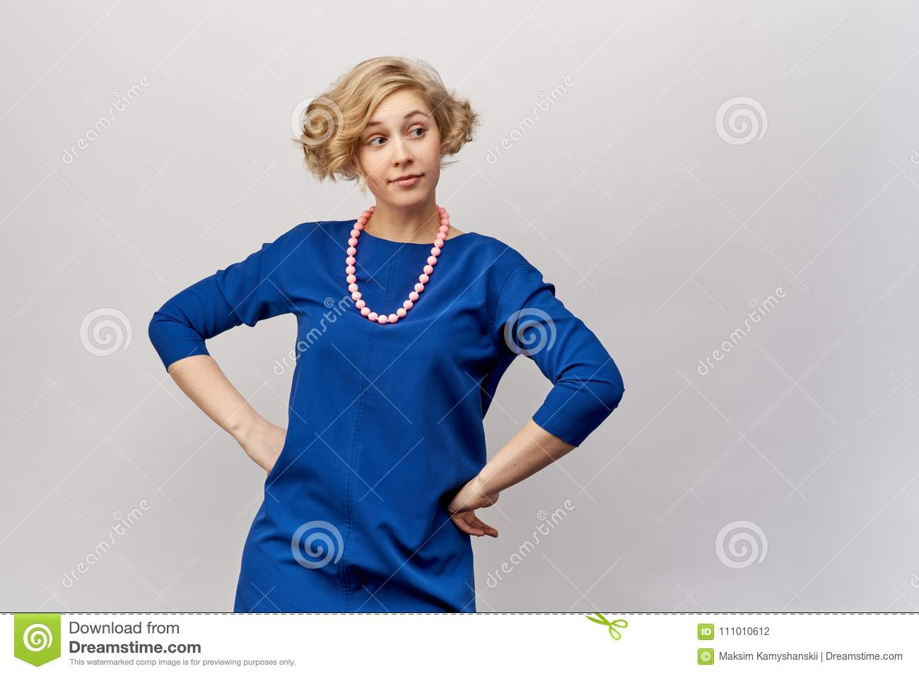 ebbf978be Young Blonde With Short Hair And Curls, Posing For Studio Shooting ...
