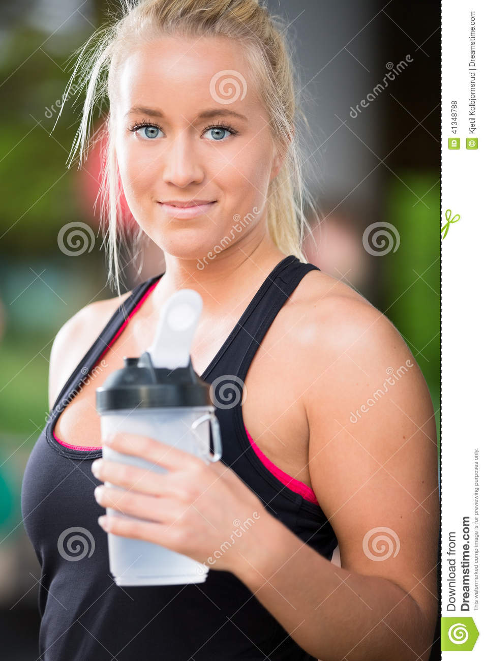 Young Blonde Woman Drink Water At Crossfit Center Stock