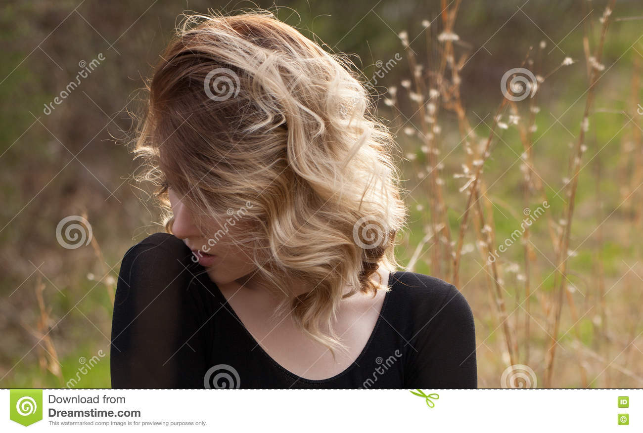 Young Blonde Woman Outside