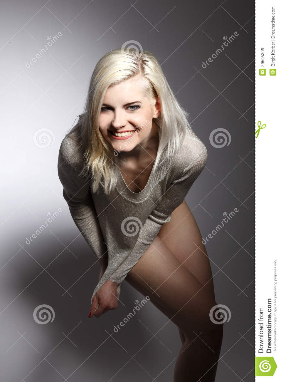 Young blonde woman wearing beige sweater