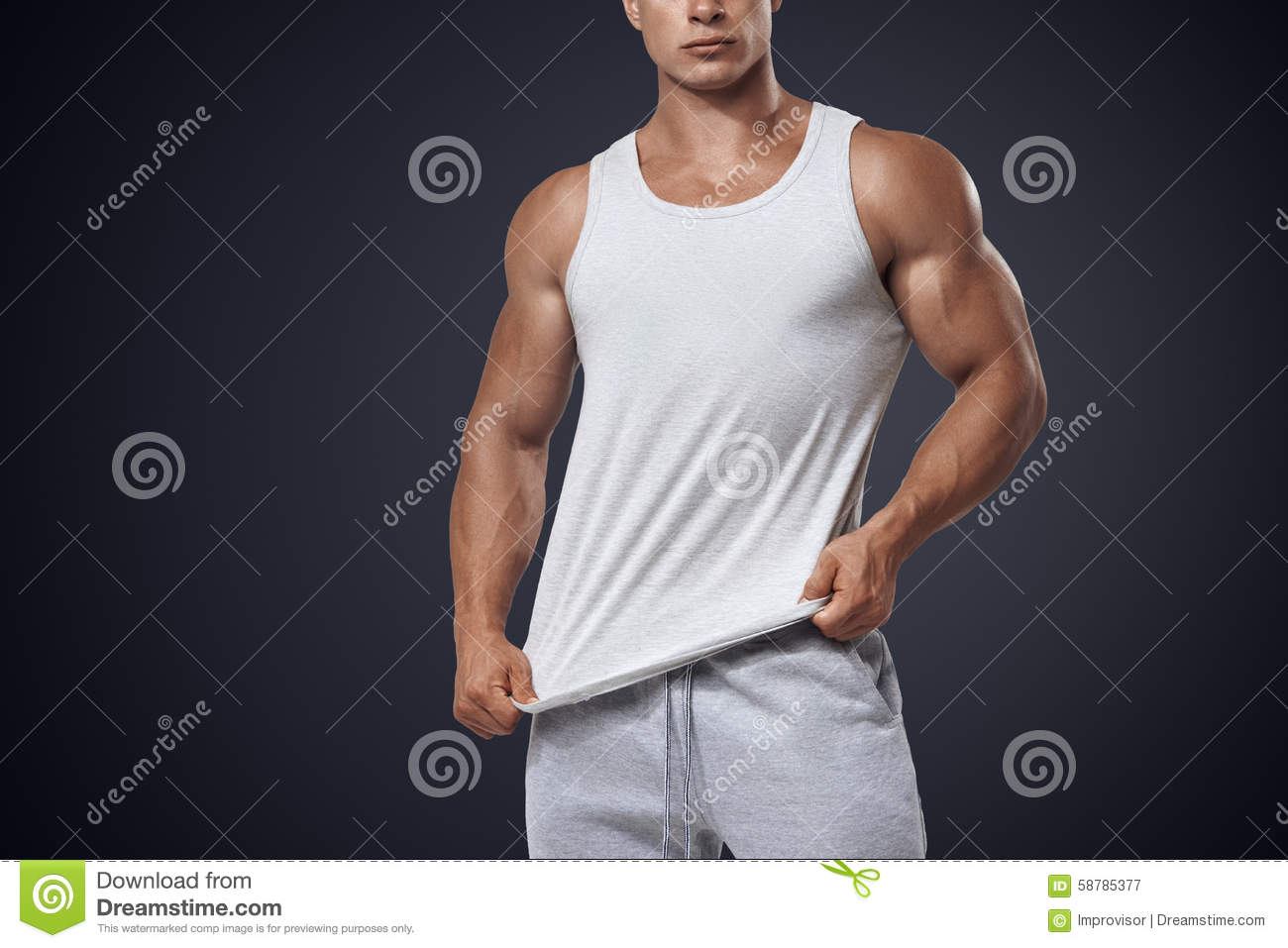 d5a0bc1dacb8a Close up photo of attractive bodybuilder wearing blank white sleeveless t- shirt