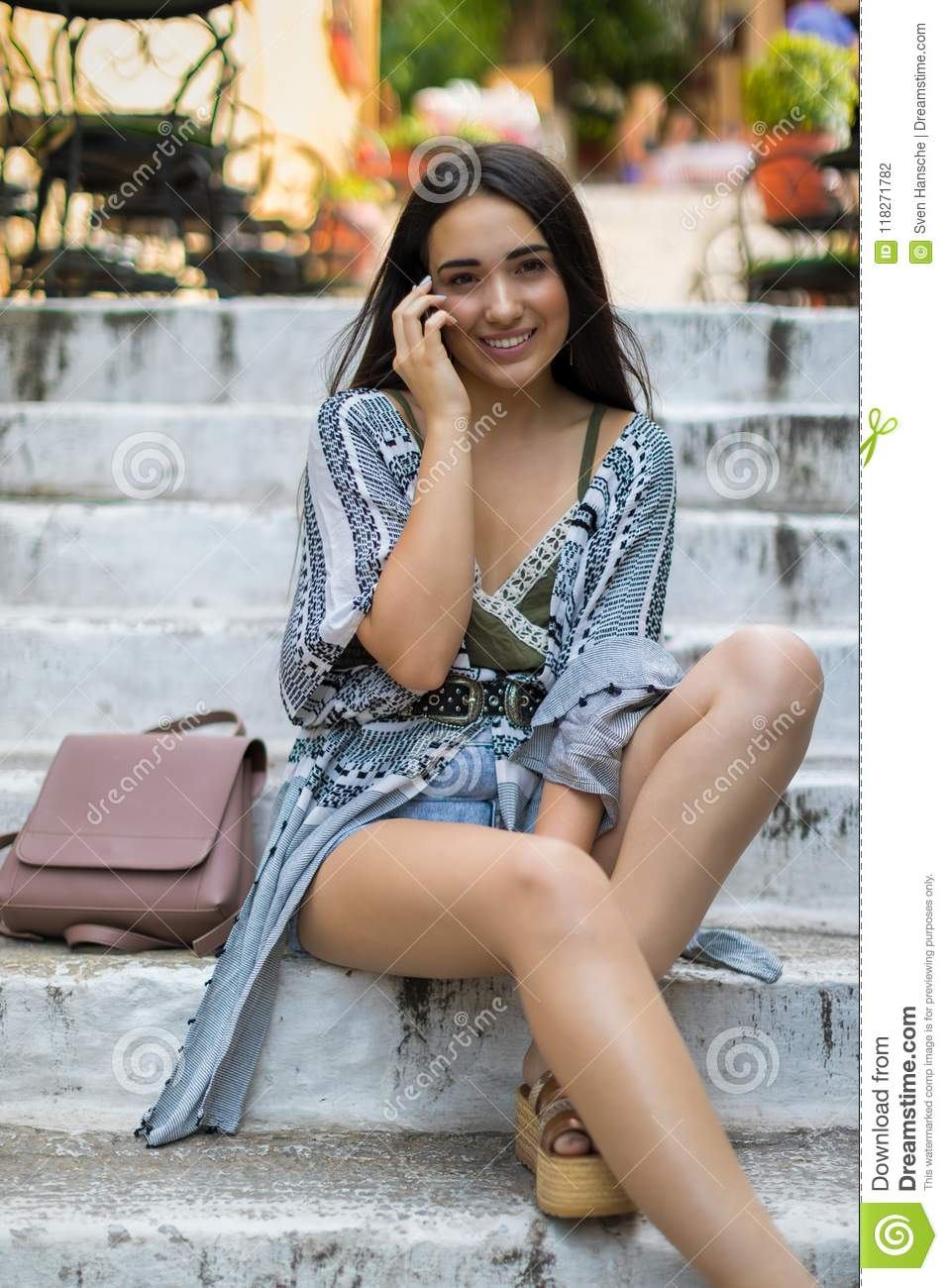 Young bohemian like dressed woman in mediterranean city concept