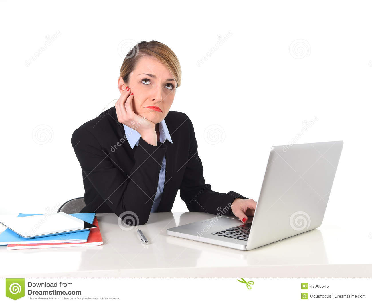 young bored businesswoman working in stress at office computer