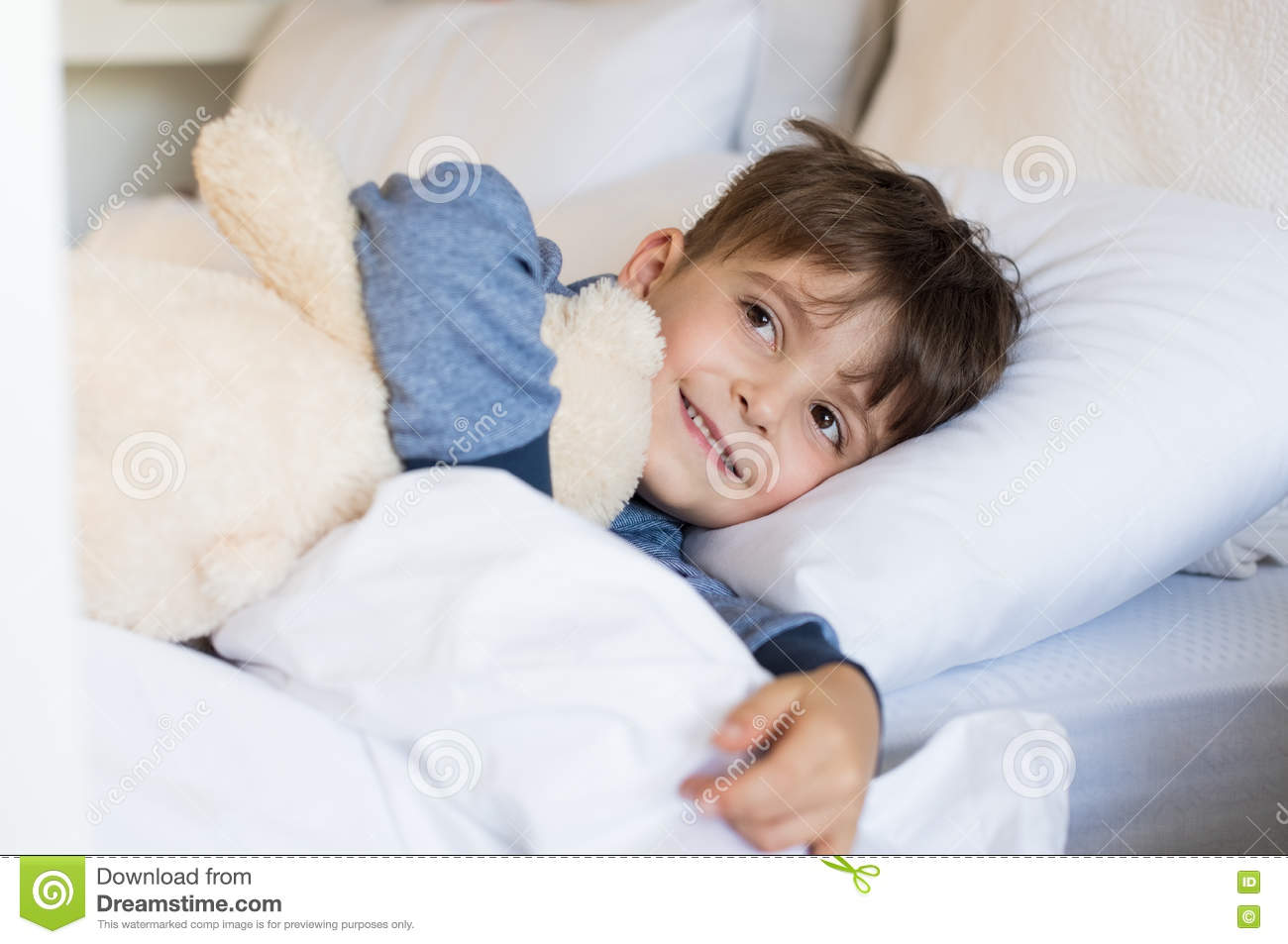 young boy in bed stock photo image of embracing sleeping 70945546. Black Bedroom Furniture Sets. Home Design Ideas