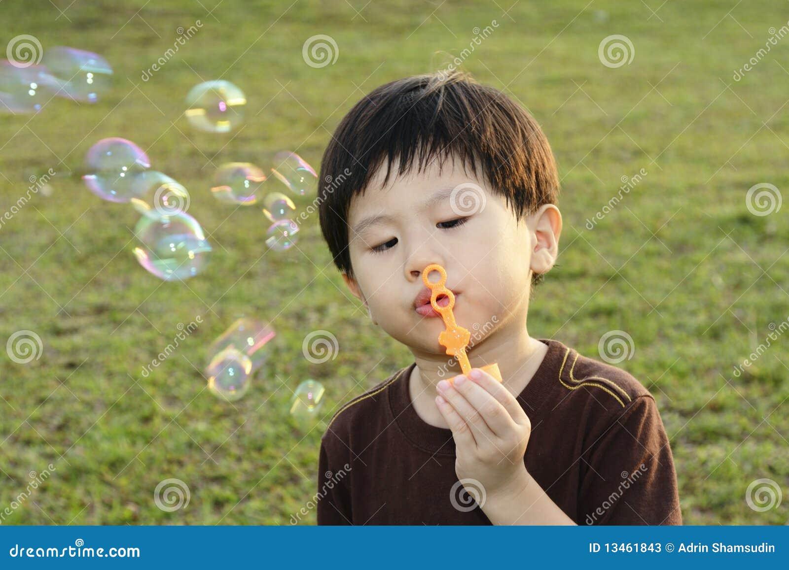 blowing boy