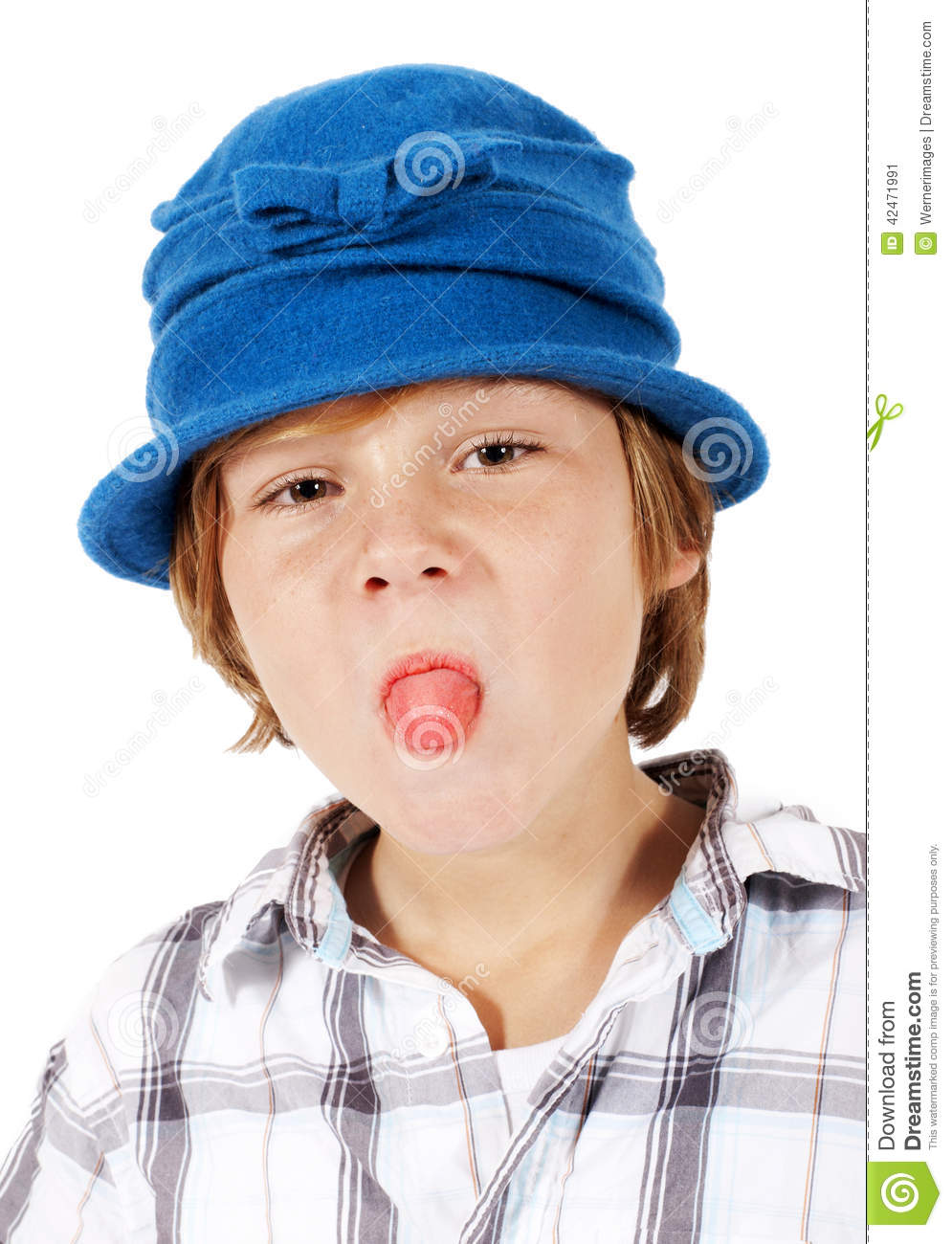 Portrait of a blond boy wearing a silly blue hat and sticking his tongue out 2c99007be73