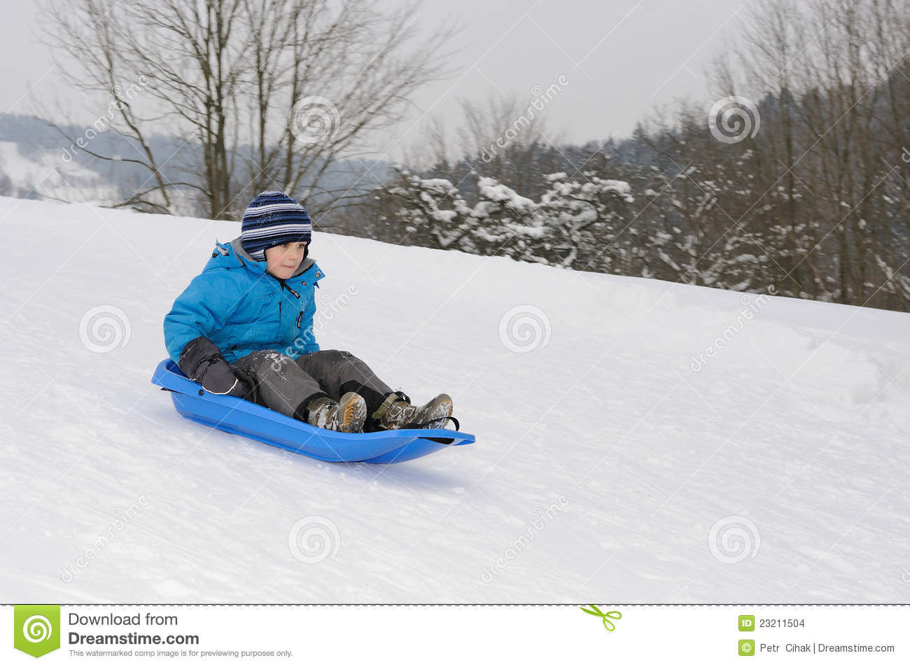 Young boy on blue sled stock photo. Image of hill, sledge