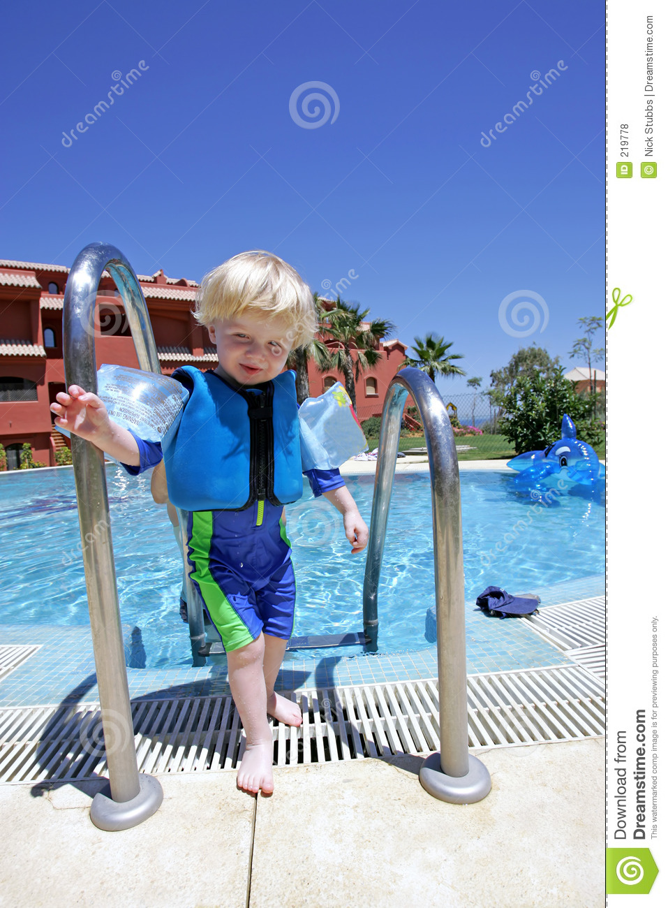 Young Boy Climbing Out Of Swimming Pool On Vacation Royalty Free Stock Photos Image 219778