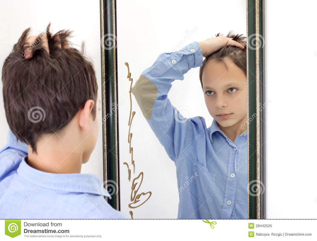 Boy Comb Hair Young boy combing his hair in