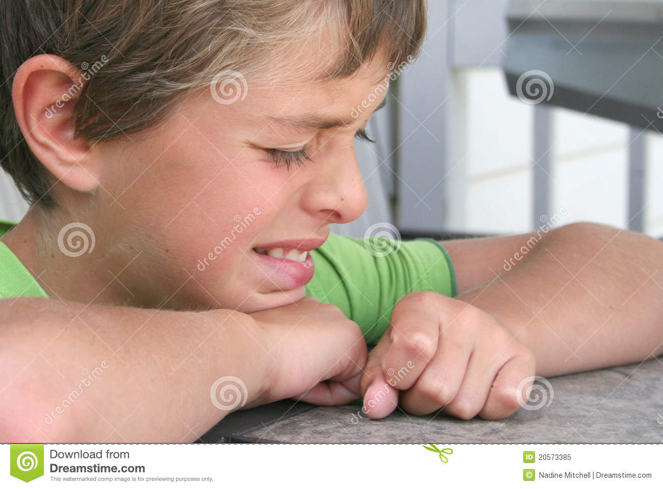 Young boy crying at a table