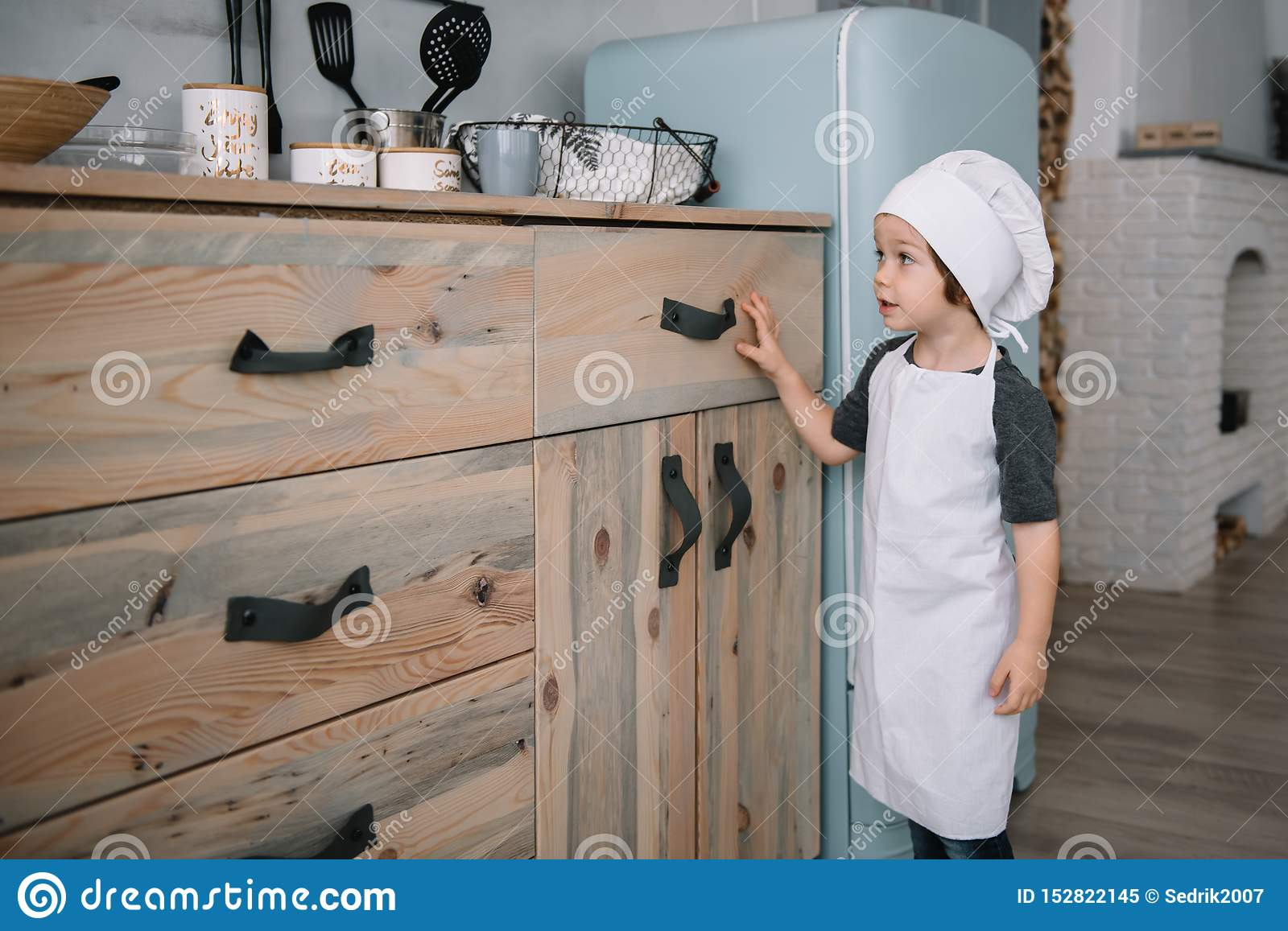 Young Boy Cute On The Kitchen Cook Chef In White Uniform ...