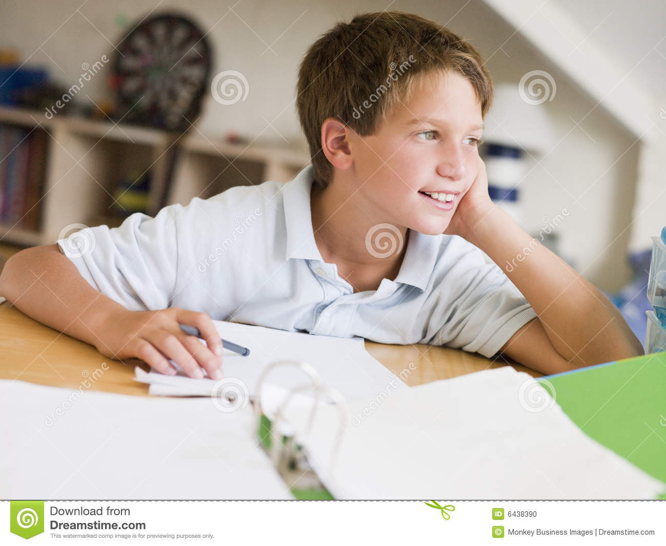 Young Boy Doing Homework In His Room Stock Photo Image