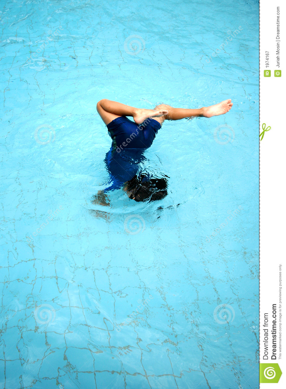 A young boy doing a somersault in the swimming pool American home shield swimming pool coverage