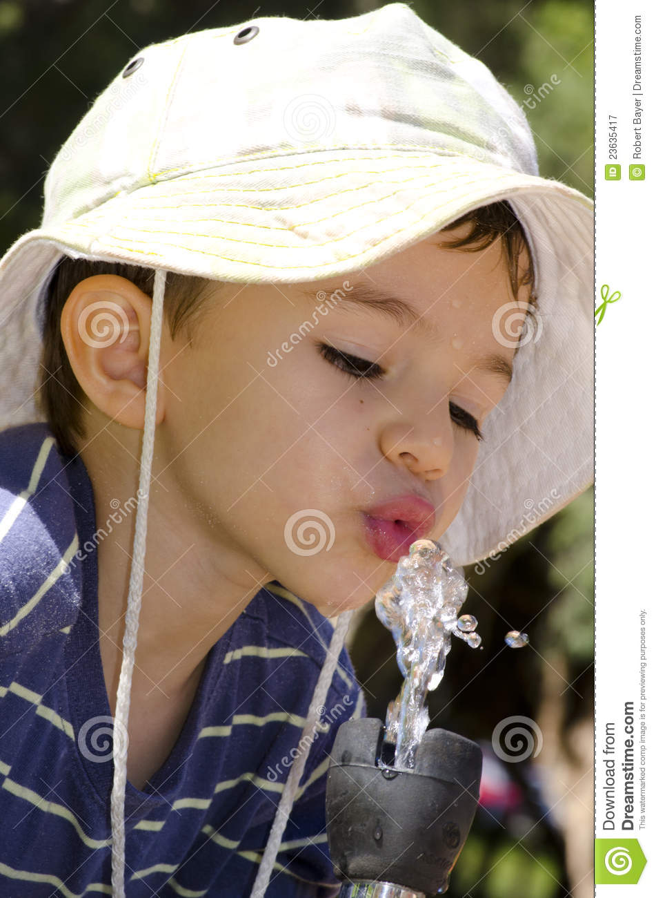 Young Boy Drinking Water At Fountain Royalty Free Stock