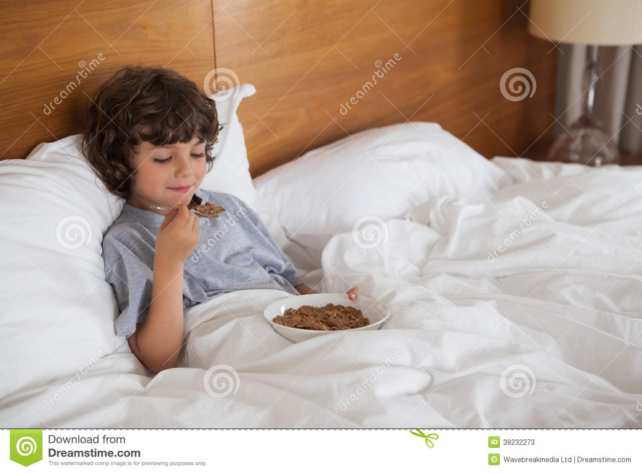 Young Boy Eating Breakfast In Bed Stock Image Image Of Bowl Brown 39232273