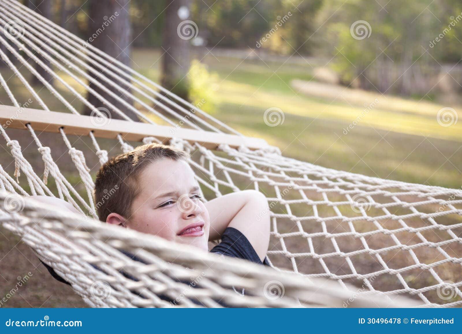 Young Boy Enjoying A Day in His Hammock