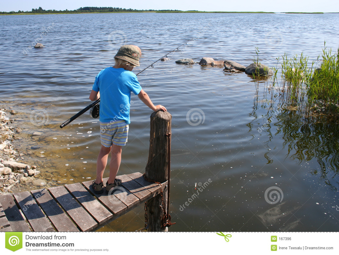 Young boy fishing stock photo image of line patient for Fishing times free