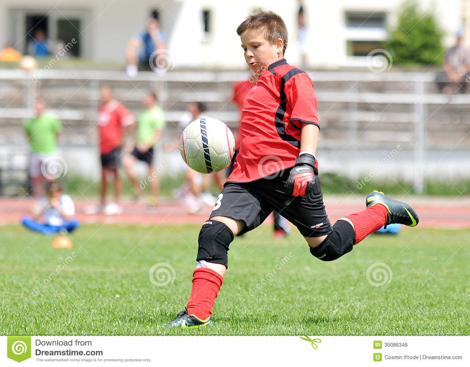 Young boy football or soccer goalkeeper