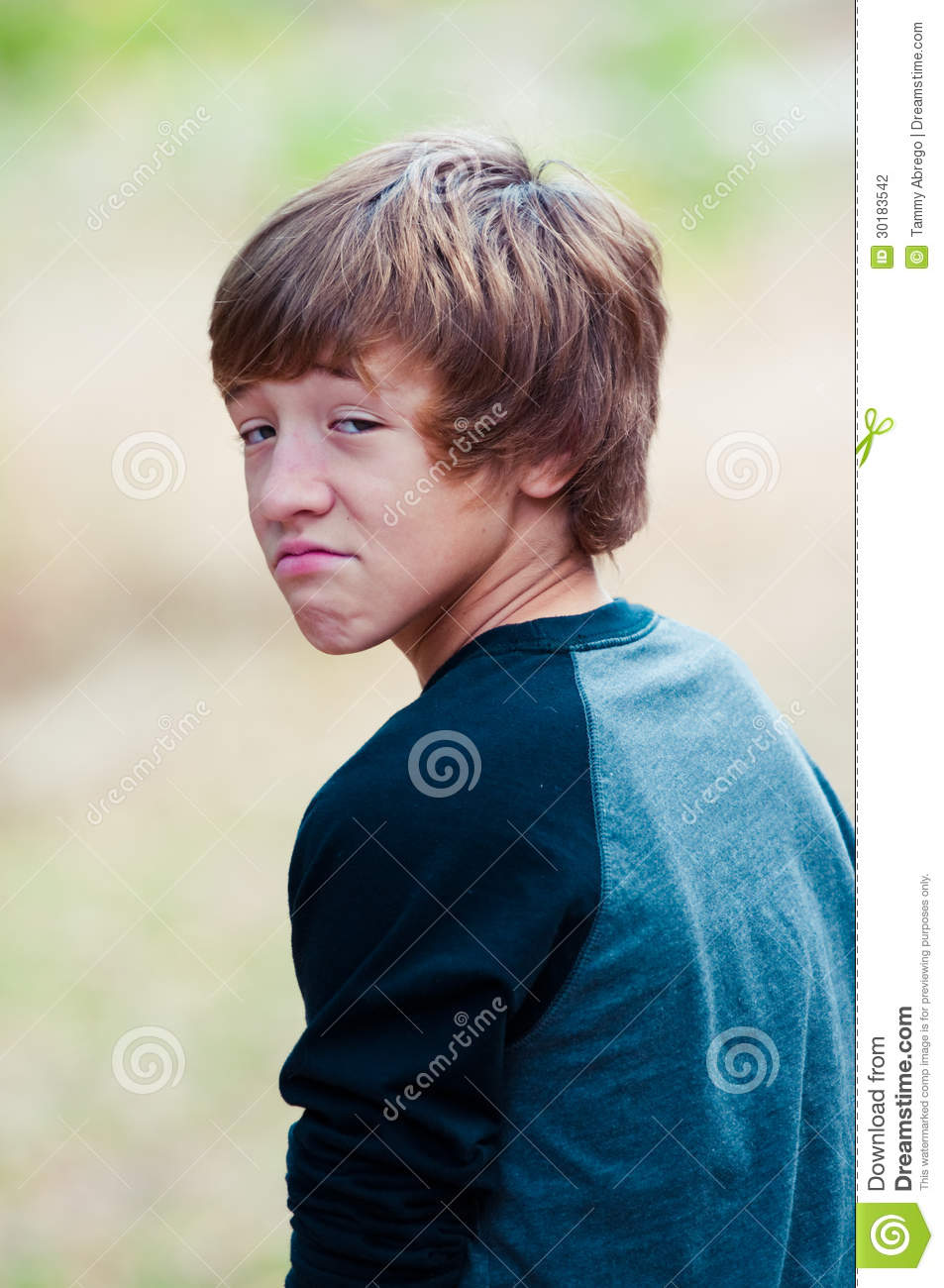 Young Teen Looking At Camera With Frown Face Stock