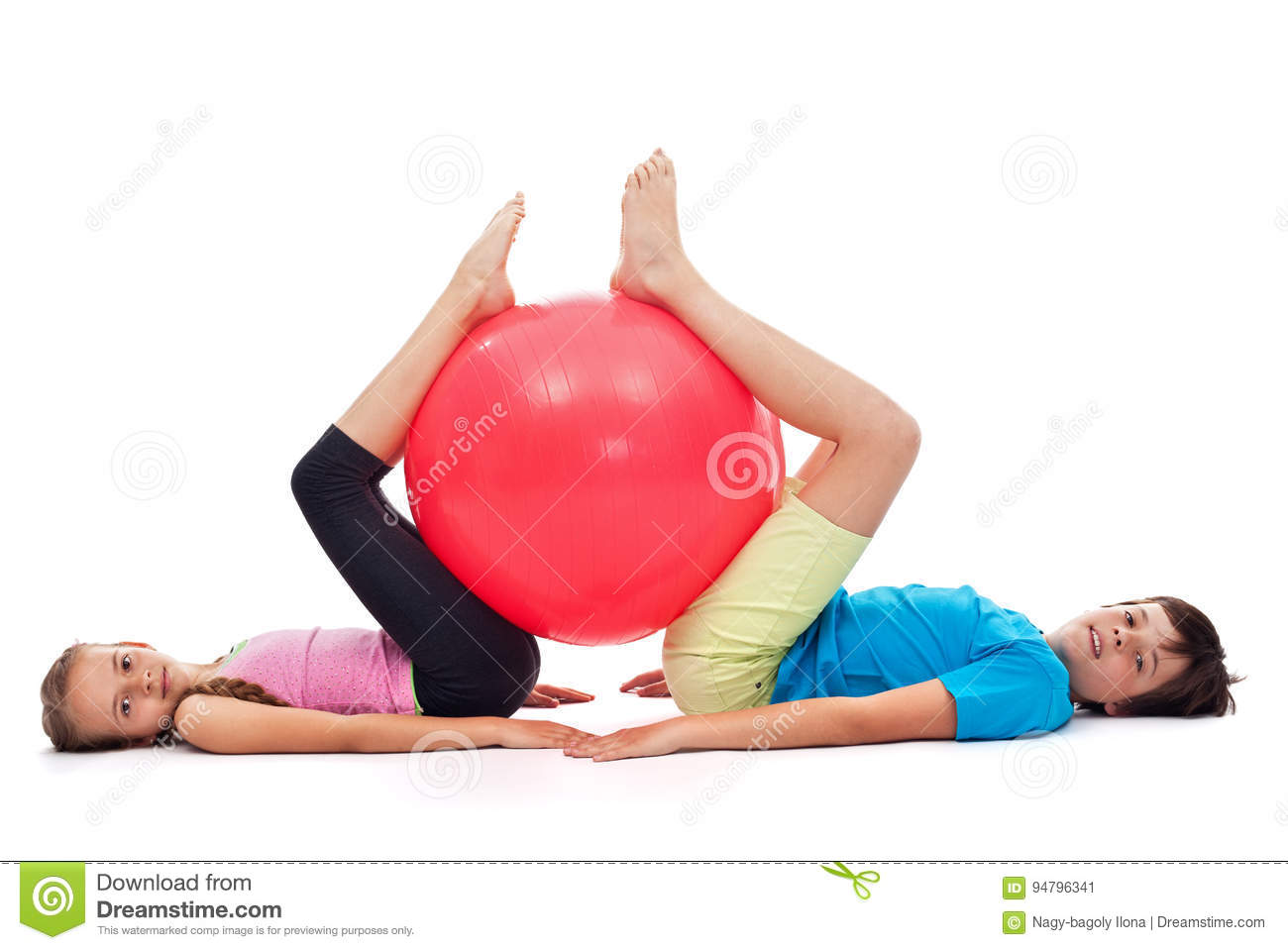 Young boy and girl exercising with a large gymnastic rubber ball