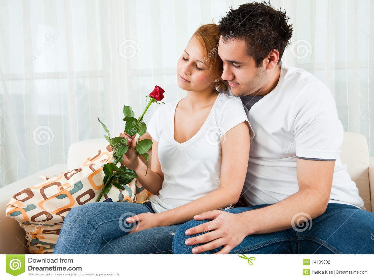 Young boy giving rose to a beauty, young girl