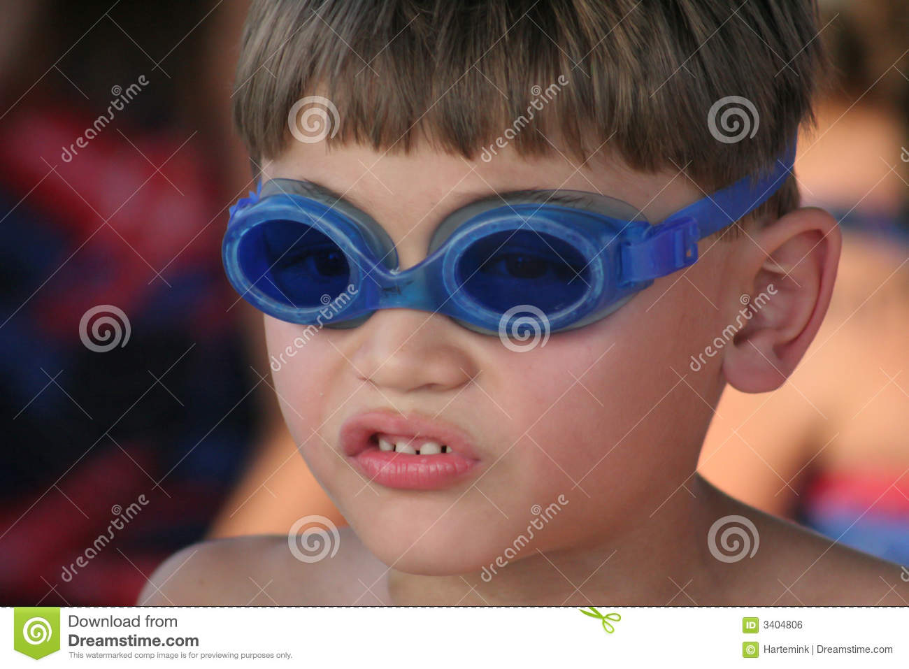 Young boy with goggles to swim