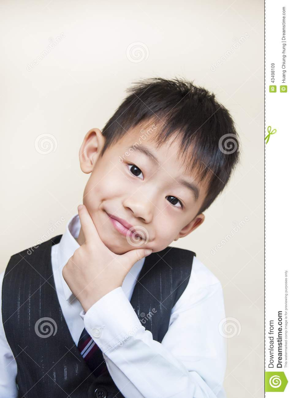 Young boy with hands on chin