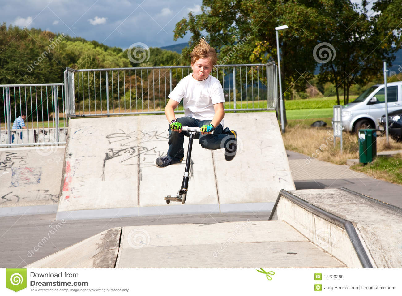 Young Boy Jumps With Scooter Over A Ramp At The Sk Royalty