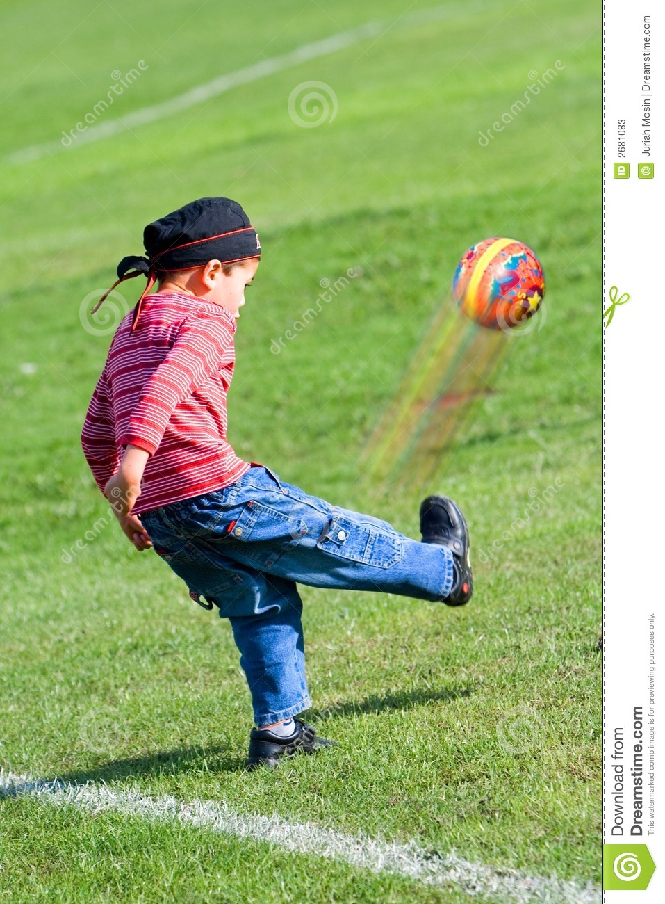 young boy kicks rubber ball stock image image of conditioning