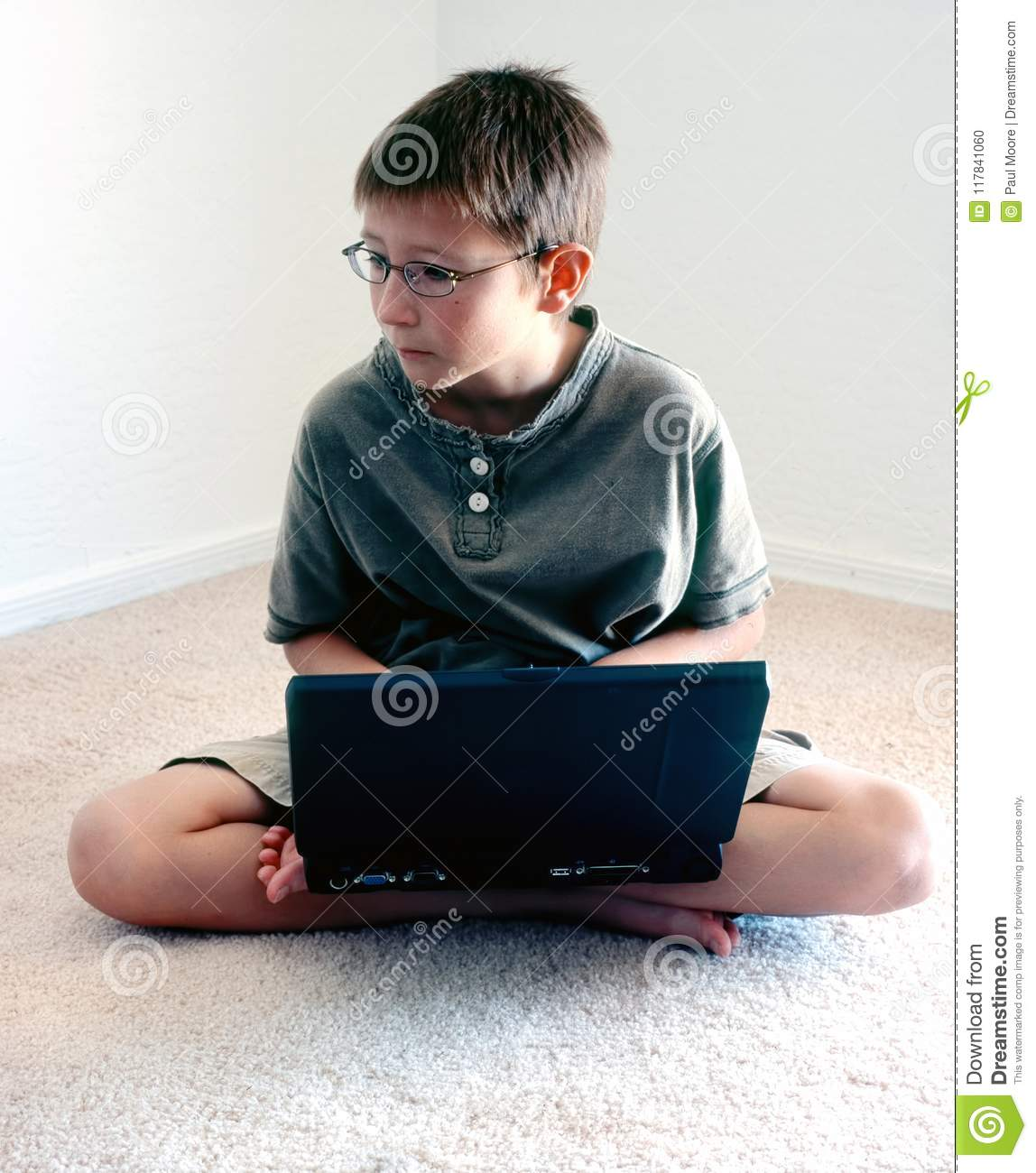 Young boy with laptop computer