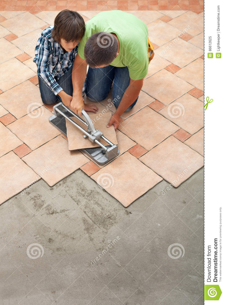 Young boy learning how to cut a ceramic floor tile stock image young boy learning how to cut a ceramic floor tile dailygadgetfo Image collections