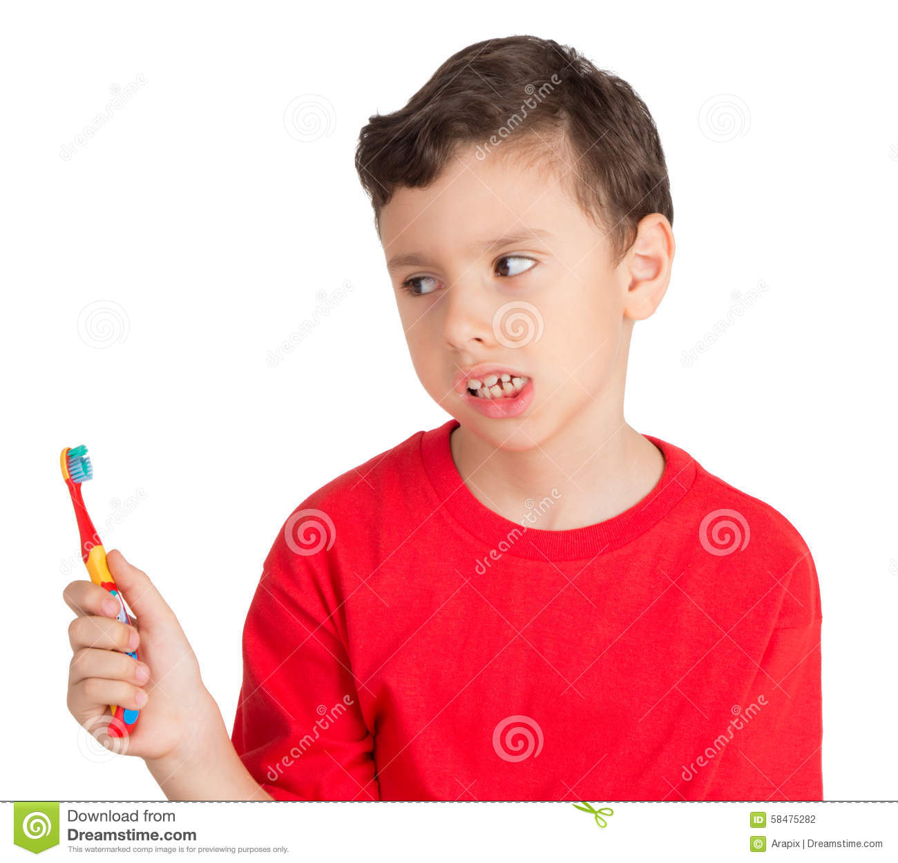 Young boy looking in angry way to his teeth brush