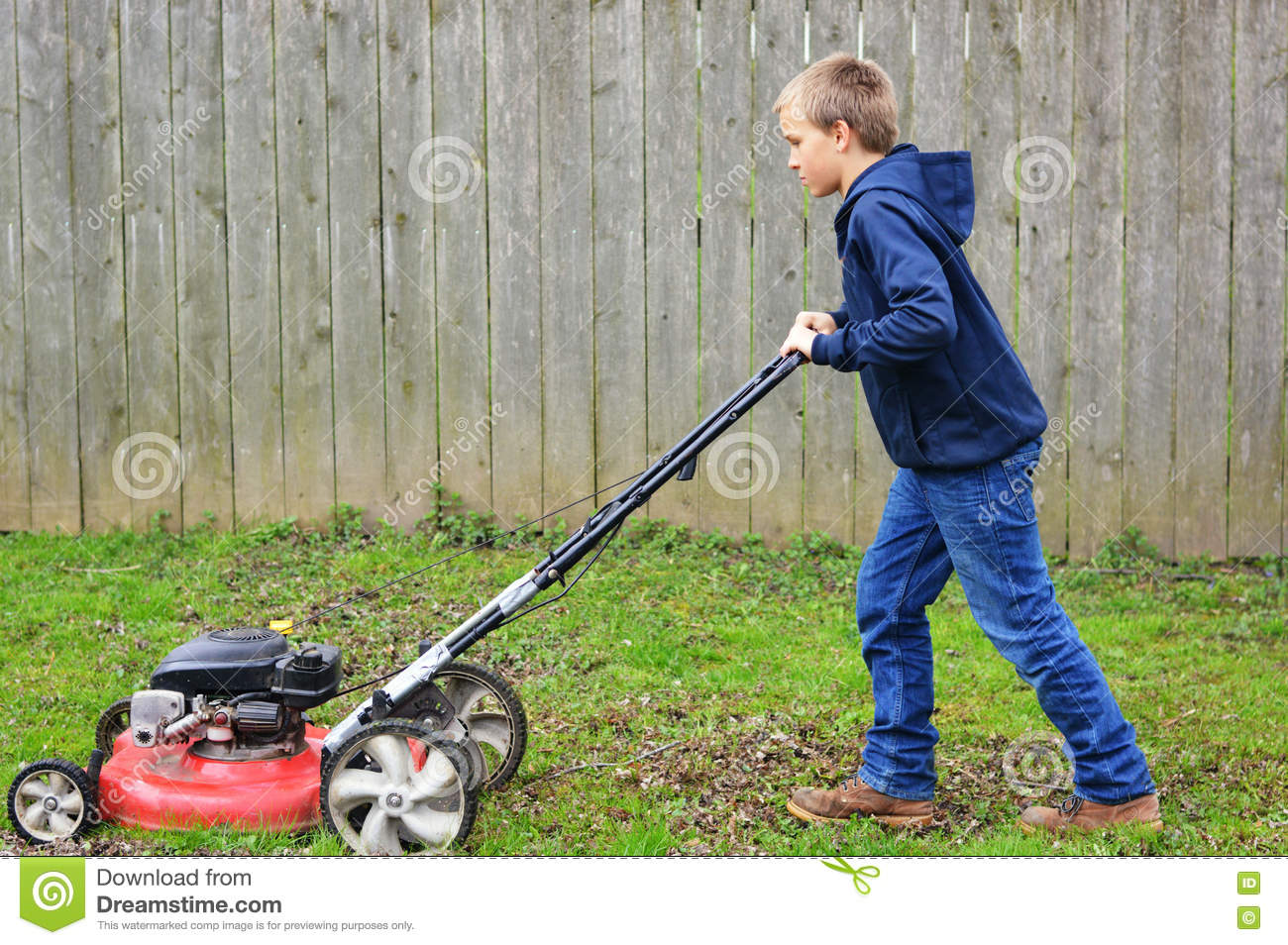 Young Boy Mowing Lawn