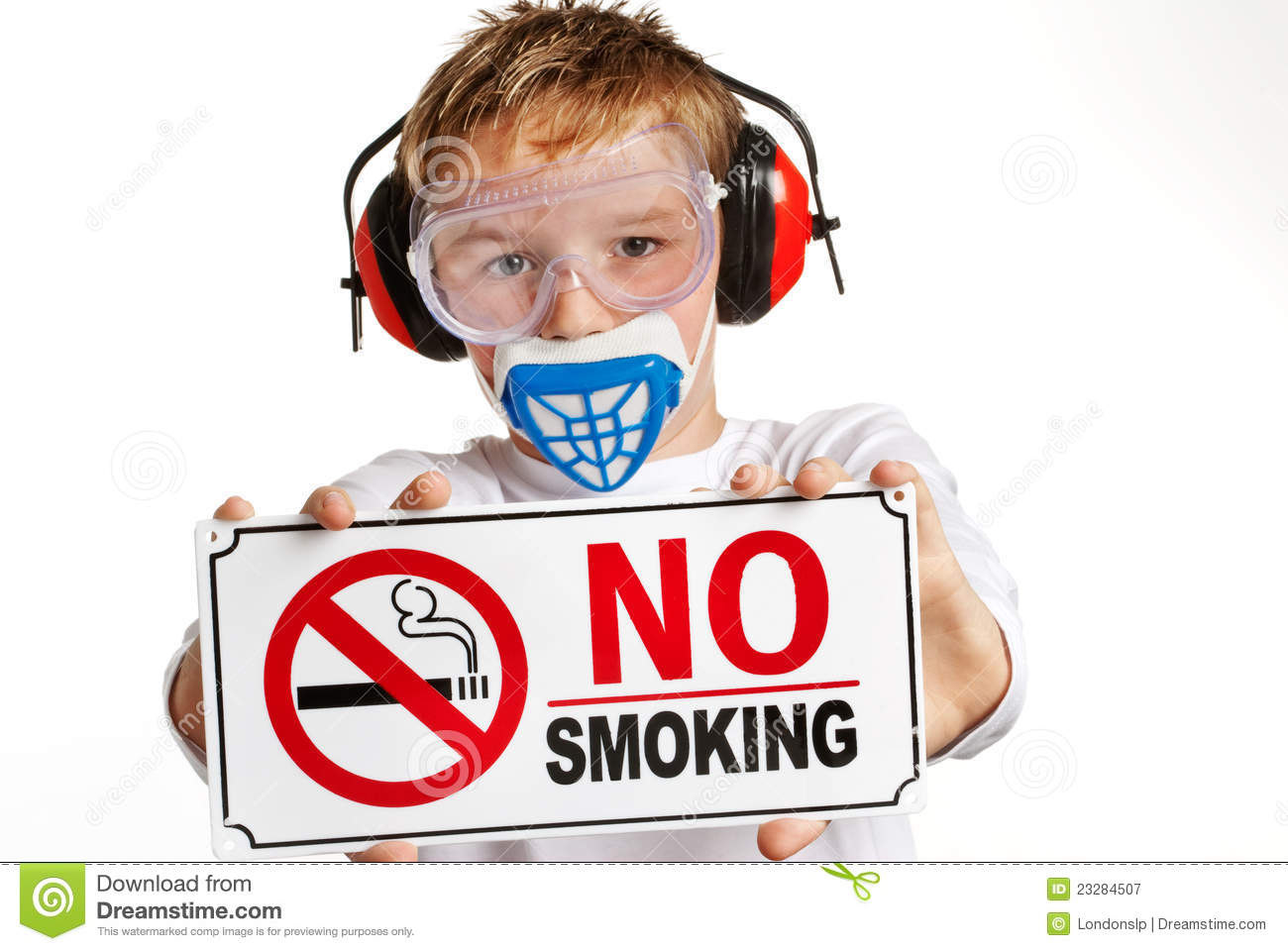 Young boy with no-smoking sign.