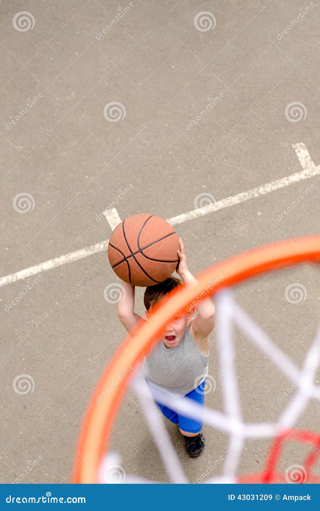 Young Boy Playing Basketball Stock Image - Image of pants ...