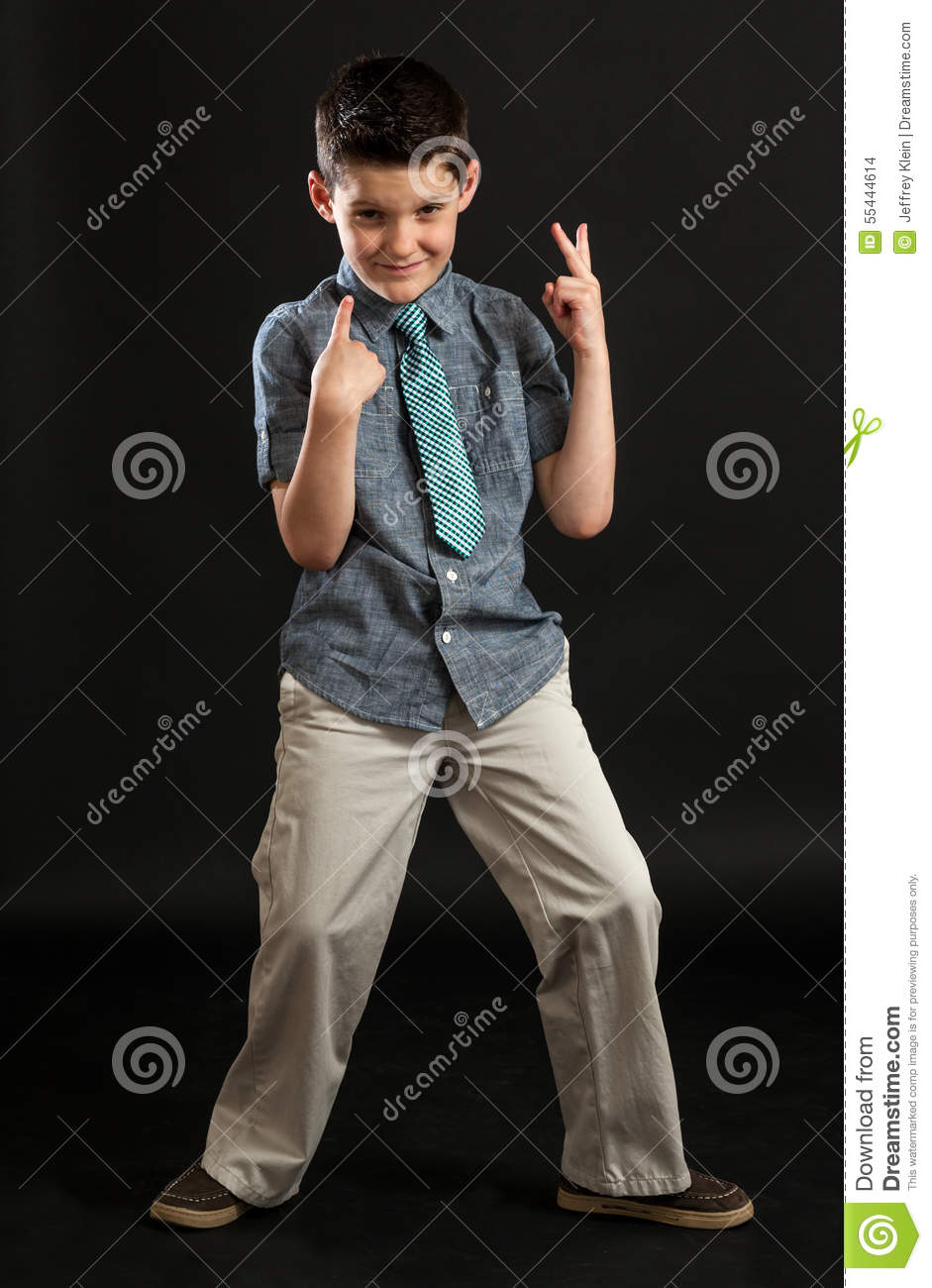 young boy point to self making peace sign stock photo image of