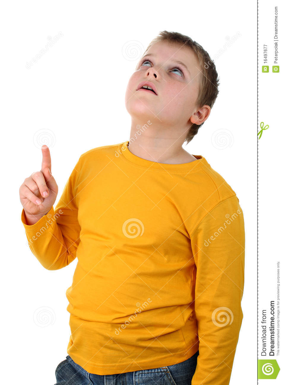 ... Stock Photography: Young boy points his finger up isolated on white