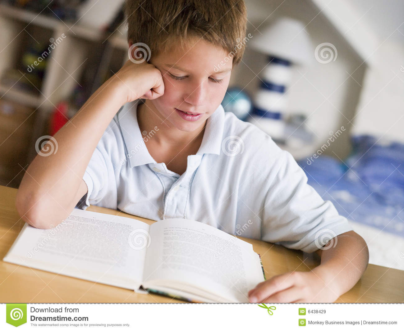 Young Boy Reading A Book In His Room Royalty Free Stock