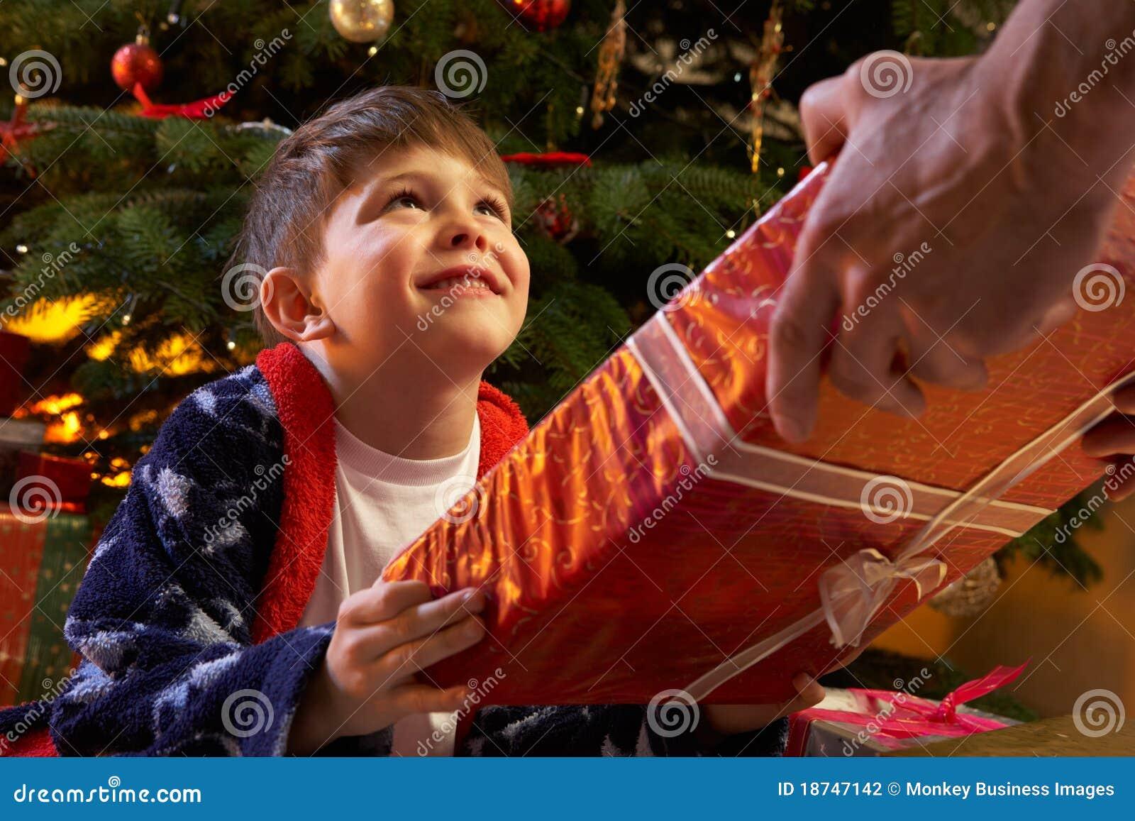 Young Boy Receiving Christmas Present