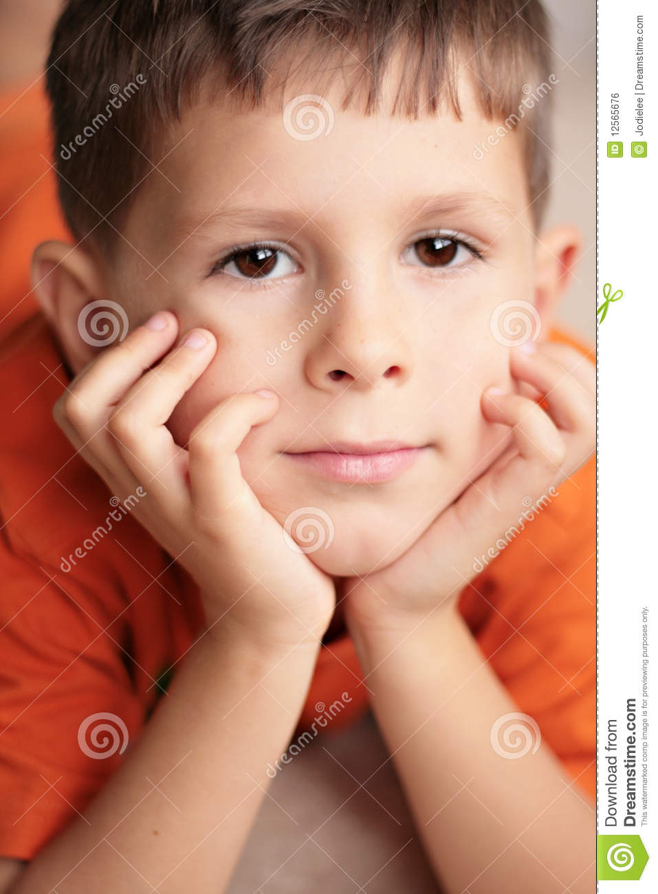Young Boy Relaxed Smiling With Hands On Chin Royalty Free ...