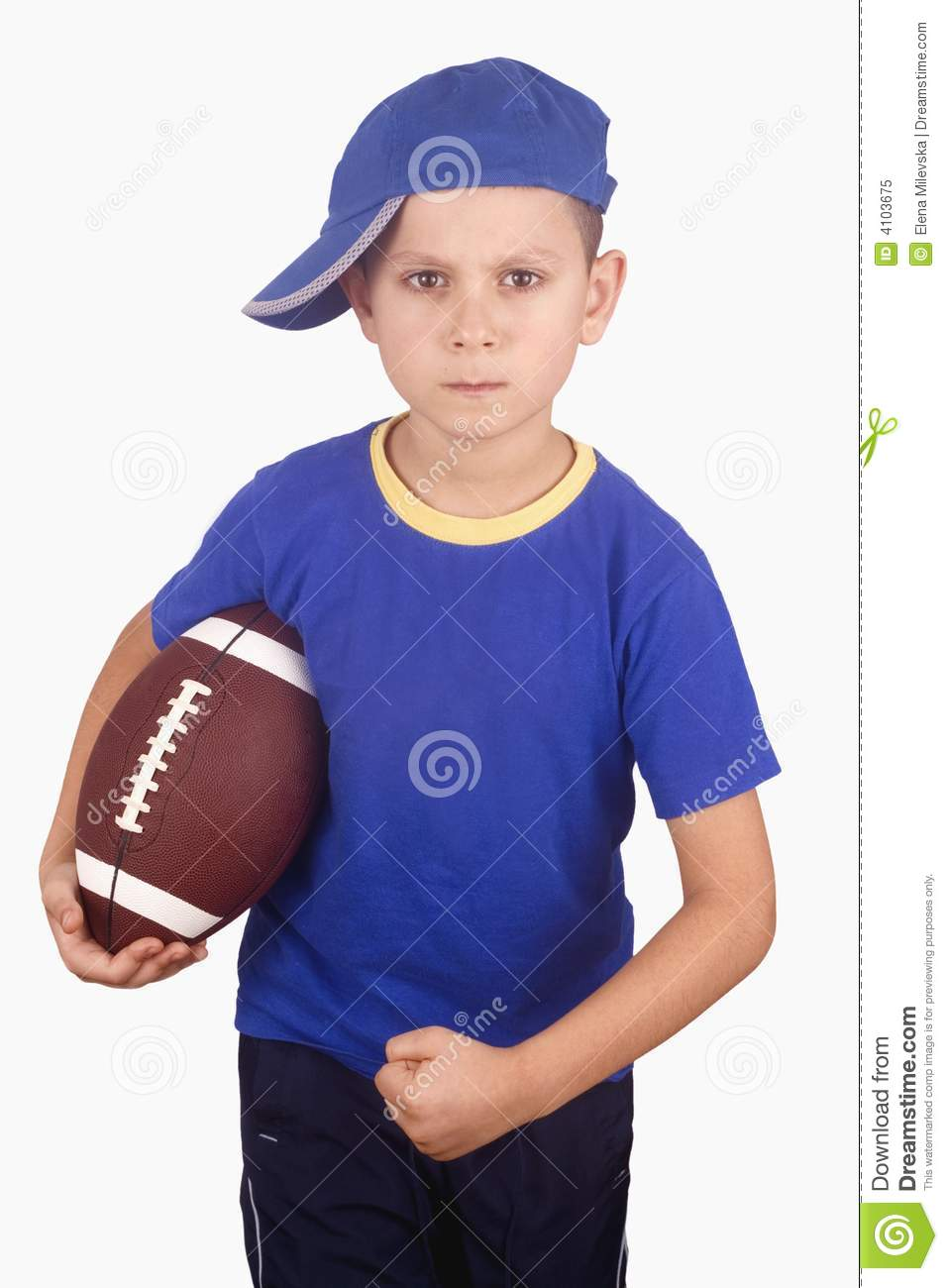 Young boy and rugby ball
