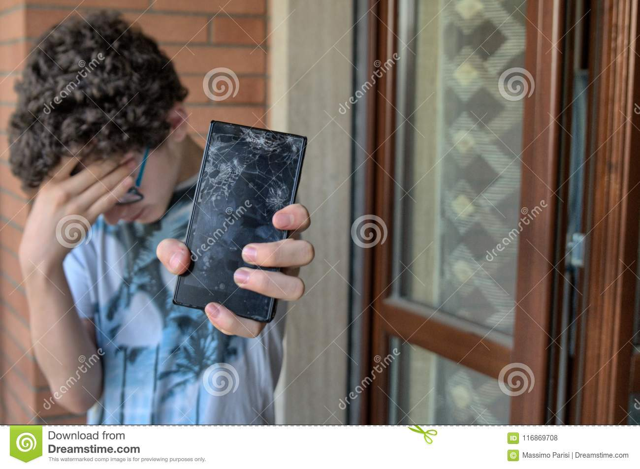 Young boy, sad and desperate for his smartphone
