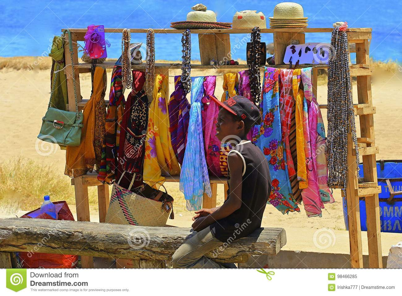 Young boy selling goods on the beach